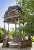 Stone arbor with a bowl with sacred source in the territory of Yuryev Monastery, Great Novgorod, Russia. — Stock Photo