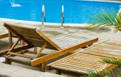 Deckchairs at the pool — Stock Photo