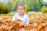 Little girl enjoy in autumn leaves — Stock Photo