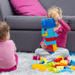 Little Girl and Baby Playing Together — Stock Photo #63166337