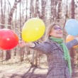 Happy Young Woman With Colorful Balloons — Stock Photo #66990833