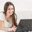 Happy Beautiful Young Student Girl Using Laptop — Stock Photo #67990957