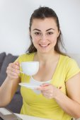 Smiling Young Woman Drinking Coffee — Stock Photo