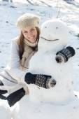 Winter Happy Woman And Snowman — Stock Photo