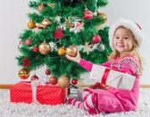 Happy Little Girl with Christmas Gift — Stock Photo