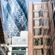 LONDON, UK - AUG 6: The Gherkin Tower (30 St Mary Axe) in the Ci — Stock Photo #64916745
