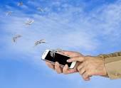 Smartphone in hand — Stock Photo