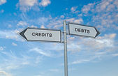 Road signs to credits and debts — Stock Photo