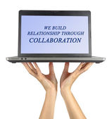 """Notebook showing """"We build relationship through collaboration"""" — Stock Photo"""