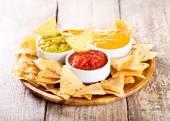 Nachos with various sauces — Stock Photo