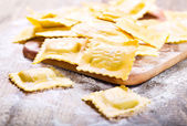 Raw ravioli with flour — Stock Photo