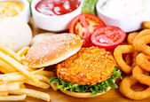 Burger with chicken and fries — Stock Photo