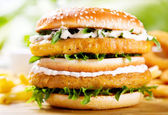 Double burger with chicken — Stock Photo