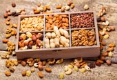 Various dried nuts in wooden box  — Stock Photo