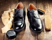 Black  shoes with care accessories — Foto Stock