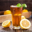 Glass of ice tea with mint and lemon — Stock Photo #71353607