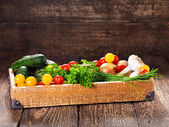 Vegetables and herbs in wooden box — Stock Photo