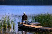 Old fisherman — Stock Photo