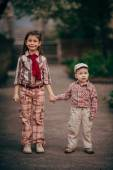 Small boy and his sister go for the walk — Stock Photo