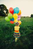 Little girl with colorful balloons — Stock Photo