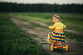 Little girl biking on the road — ストック写真