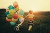 Little girl with colorful balloons — Стоковое фото