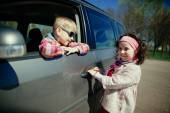 Little girl and boy driving car — Stock Photo