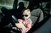 Little boy driving fathers car — ストック写真