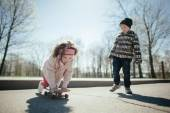 Little boy and girl skaiting on the street — Stock Photo
