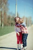 Little boy kiss girl on the street — Stock Photo