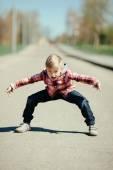 Little boy grimacing on the street — Stock Photo
