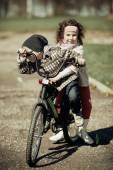 Little girl and boy riding on bicycle together — Stock Photo