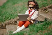 Little girl with tablet — Stock Photo