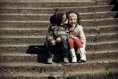 Litle boy kissing girl — Stock Photo