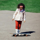 Little girl with skateboard — Stock Photo