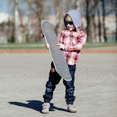 Little boy with skateboard on the street — Stock Photo