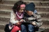 Boy and girl using tablet — ストック写真