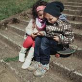 Boy and girl using tablet — Stock Photo