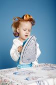 Little funny housewife with iron — Stock Photo