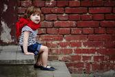 Cute little girl on stairway — Stock Photo