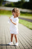 Little girl drinking clean water from bottle — Stock Photo