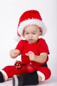Kleine süße junge mit nikolausmütze — Stockfoto