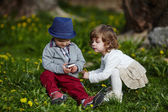 Boy and girl playing with mobile phone — Stock Photo