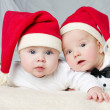Cute babies with santa hats — Stock Photo #57173385