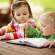 Little boy and girl learning to write — Stock Photo #59087315