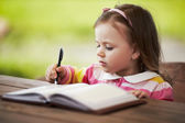 Cute little girl learning to write — ストック写真