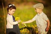 Boy and girl in summer field — Stock Photo