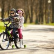 Girl and boy riding on bicycle — Stock Photo #60066273