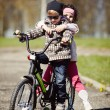 Girl and boy riding on bicycle — Stock Photo #60066563