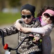 Girl and boy riding on bicycle — Stock Photo #60066879